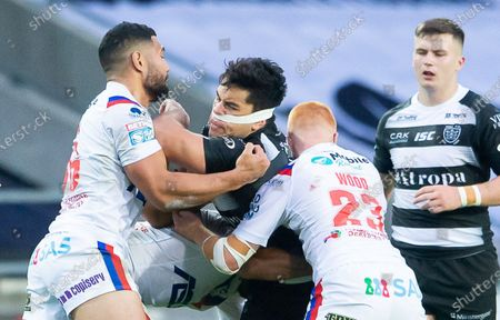 Hull FC's Andre Savelio is tackled by Wakefield's Kelepi Tanganoa & Josh Wood.