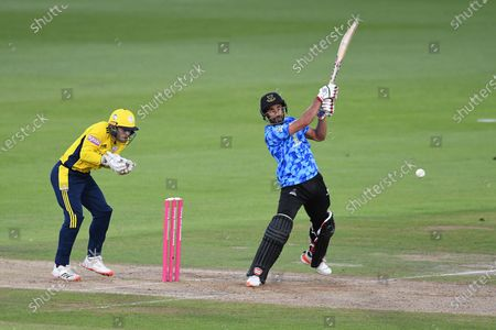 Wicket - Ravi Bopara of Sussex hits a delivery from Calvin Harrison to James Vince during the Vitality T20 Blast South Group match between Hampshire County Cricket Club and Sussex County Cricket Club at the Ageas Bowl, Southampton
