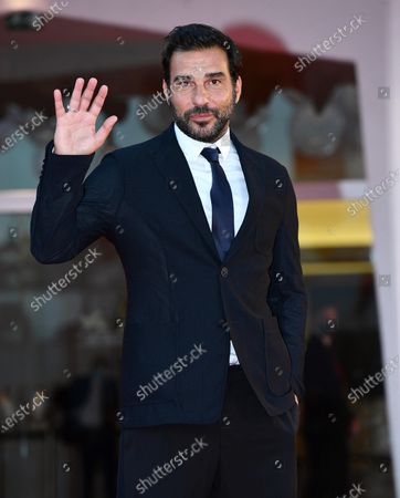 Edoardo Leo arrives for the premiere of 'Nuevo Orden (New Order)' during the 77th annual Venice International Film Festival, in Venice, Italy, 10 September 2020. The movie is presented in the official competition 'Venezia 77' at the festival running from 02 September to 12 September. The event is the first major in-person film fest to be held in the wake of the Covid-19 coronavirus pandemic. Attendees have to follow strict safety measures like mandatory face masks indoors, temperature scanners, and socially distanced screenings to reduce the risk of infection. The public is barred from the red carpet, and big stars are expected to be largely absent this year.