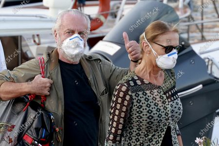 Napoli president Aurelio De Laurentiis (L), accompanied by his wife Jacqueline De Laurentiis, upon his arrival at the Luise pier on the Naples seafront, Naples, Italy, 10 September 2020. On 10 September 2020 Napoli announced that president Aurelio De Laurentiis tested positive for COVID-19 coronavirus. On 09 September 2020 De Laurentiis attended a meeting with officials from the 20 Italian Serie A clubs.