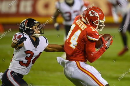 Kansas City Chiefs wide receiver Sammy Watkins (14) makes a catch in front of Houston Texans cornerback John Reid (34) during an NFL football game, in Kansas City, Mo