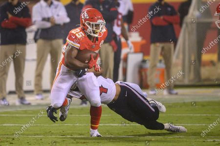 Houston Texans cornerback John Reid (34) tries to tackle Kansas City Chiefs running back Clyde Edwards-Helaire (25) during an NFL football game, in Kansas City, Mo