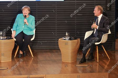 German Chancellor Angela Merkel and Donald Tusk, President of the European People's Party (EPP), during a panel discussion on '30 Years of German Unity' in Berlin, Germany, 10 September 2020. Germany on 03 October 2020 marks the 30th anniversary of the German Reunification.