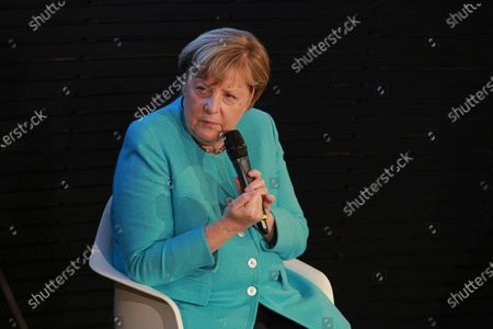 German Chancellor Angela Merkel and Donald Tusk (not pictured), President of the European People's Party (EPP), during a panel discussion on '30 Years of German Unity' in Berlin, Germany, 10 September 2020. Germany on 03 October 2020 marks the 30th anniversary of the German Reunification.