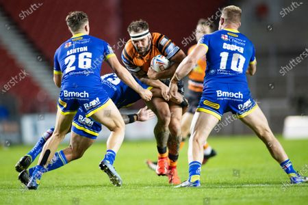George Griffin of Castleford is tackled by Ben Murdoch-Masila, Matty Ashton and Mike Cooper of Warrington.