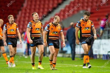 Castleford's Greg Eden, Paul McShane & Alex Foster dejected after their side's narrow last minute loss to Warrington.