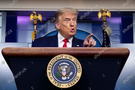 United States President Donald J. Trump holds a news briefing in the James Brady Press Briefing Room of the White House in Washington, DC, USA, 10. Trump fielded questions regarding comments he made to journalist Bob Woodward, author of the forthcoming book 'Rage', that downplayed the threat of the coronavirus.