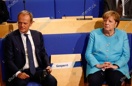 Stock Image of German Chancellor Angela Merkel and Donald Tusk, former President of the European Council, take part in an event of the Konrad-Adenauer-Stiftung, Konrad Adenauer Foundation, on the occasion of 30 years of German reunification. in Berlin, Germany
