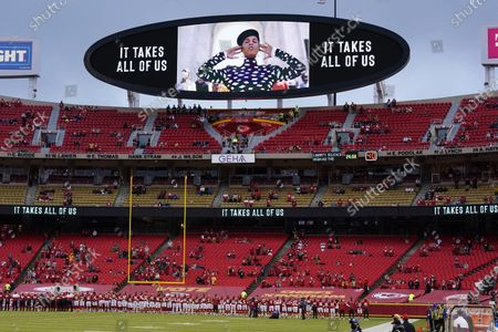 Kansas City Chiefs players and fans stand as a song by Alicia Keys is played during a presentation on social justice before an NFL football game against the Houston Texans, in Kansas City, Mo
