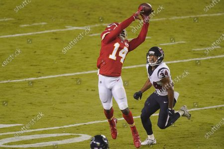 Stock Photo of Kansas City Chiefs wide receiver Sammy Watkins (14) catches a pass over Houston Texans cornerback John Reid (34) in the first half of an NFL football game, in Kansas City, Mo