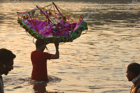 Pakistani devotees gather along with their symbolic paper boats, an offering to Muslim saint Abdul Qadir Gilani as a way of giving thanks after their desire to give birth to a son was fulfilled, before dropping it into the water during an annual ceremony on the banks of the River Ravi in Lahore. The ceremony commemorates a centuries-old tale that saint Abdul Qadir Gilani raised a sunken ship carrying a wedding party, at the pleading of the groom's mother, saving all the occupants.Abdul Qadir al Gilani ,Kurdish Evdilqadirê Geylanî  known by admirers as Muhyi-i-Din Abu Muhammad Abdul Qadir al Gilani Abu al-?asani wal-?usayni was a Hanbali Sunni Muslim preacher, ascetic, mystic, jurist, and theologian, who was known for being the eponymous founder of the Qadiriyya tariqa (Sufi order) of Sufism.He was born on 29 Sha'ban 470 AH (March 23, 1078) in the town of Na'if, district of Gilan-e Gharb, Gilan, Iran, and died on Monday, February 21, 1166 (11 Rabi' al-Thani 561 AH) in Baghdad.He was a Persian Hanbali Sunni jurist and Sufi based in Baghdad The Qadiriyya tariqa is named after him.