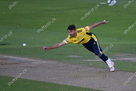Ian Holland of Hampshire tries to stop the ball hit by Luke Wright