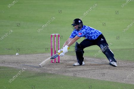 Luke Wright of Sussex Sharks playing at a wide delivery