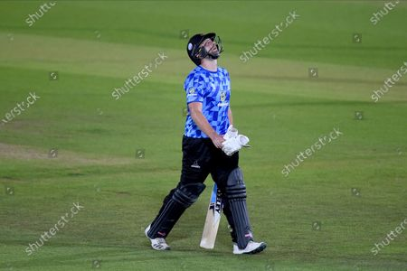 Luke Wright of Sussex Sharks looks to the sky as he is dismissed off the final ball of the innings for 83