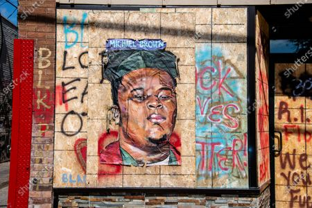An image depicting Michael Brown is seen near the George Floyd Memorial located at 38th Street and Chicago Avenue on September 10th, 2020 in Minneapolis, MN. A memorial has been setup near the location where George Floyd was killed by police. Minneapolis Police have declared they will not be removing or altering the memorial in any way.