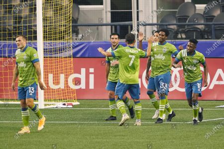 Seattle Sounders celebrate after Raul Ruidiaz, third from right, scored a goal against the San Jose Earthquakes during the first half of an MLS soccer match, in Seattle. The Sounders scored five goals in the half