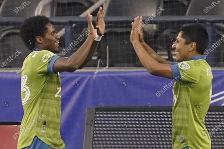 Stock Photo of Seattle Sounders' Raul Ruidiaz, right, celebrates with Joevin Jones after Ruidiaz scored a goal against the San Jose Earthquakes during the first half of an MLS soccer match, in Seattle