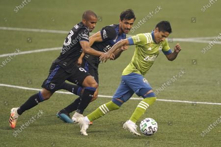 Stock Picture of Seattle Sounders'Raul Ruidiaz, right, drives the ball as San Jose Earthquakes' Judson, left, and Oswaldo Alanis, center, pursue during the first half of an MLS soccer match, in Seattle. The Sounders won 7-1