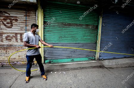 A cable operator works near closed shops  during a complete lockdown to combat the coronavirus pandemic crisis in Kolkata, eastern India, 11 September 2020. According to the latest news reports India became the second worst-hit country by the spread of novel coronavirus which causes Covid-19 disease as Indian Covid tally rose to over 4.13 million cases, overtaking Brazil and is only behind the United States.