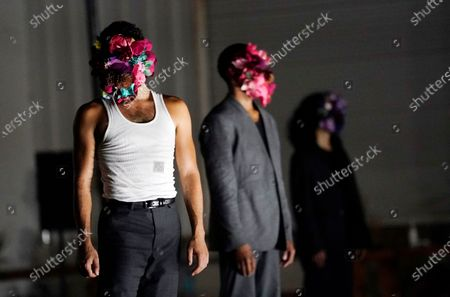 """Dancers wear ornate masks during a performance of """"Solo at Dusk,"""" a work by Bobbi Jene Smith in collaboration with Or Schraiber, during the opening night of L.A. Dance Project's Drive-In Dances series, in downtown Los Angeles. The series was conceived by L.A. Dance Project to safely bring live dance back to Los Angeles during the COVID-19 era by reimagining their 2020-2021 season as a drive-in experience"""