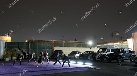 """Stock Picture of Dancers perform """"Solo at Dusk,"""" a work by Bobbi Jene Smith in collaboration with Or Schraiber, during the opening night of L.A. Dance Project's Drive-In Dances series, in downtown Los Angeles. The series was conceived by L.A. Dance Project to safely bring live dance back to Los Angeles during the COVID-19 era by reimagining their 2020-2021 season as a drive-in experience"""
