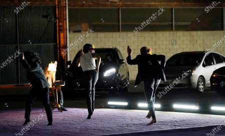 """Dancers perform """"Solo at Dusk,"""" a work by Bobbi Jene Smith in collaboration with Or Schraiber, during the opening night of L.A. Dance Project's Drive-In Dances series, in downtown Los Angeles. The series was conceived by L.A. Dance Project to safely bring live dance back to Los Angeles during the COVID-19 era by reimagining their 2020-2021 season as a drive-in experience"""
