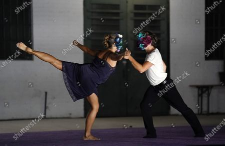 """Stock Photo of Dancers wear masks as they perform """"Solo at Dusk,"""" a work by Bobbi Jene Smith in collaboration with Or Schraiber, during the opening night of L.A. Dance Project's Drive-In Dances series, in downtown Los Angeles. The series was conceived by L.A. Dance Project to safely bring live dance back to Los Angeles during the COVID-19 era by reimagining their 2020-2021 season as a drive-in experience"""
