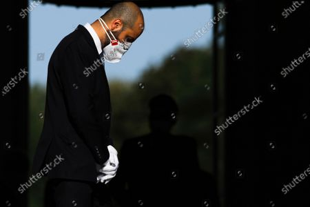 A member of German President Frank-Walter Steinmeier's protocol staff wearing a face mask and white gloves as he waits for the arrival of Croatia's President Zoran Milanovic at Bellevue Palace in Berlin, Germany, 11 September 2020. Croatian President Zoran Milanovic is on a one-day state visit to Germany.