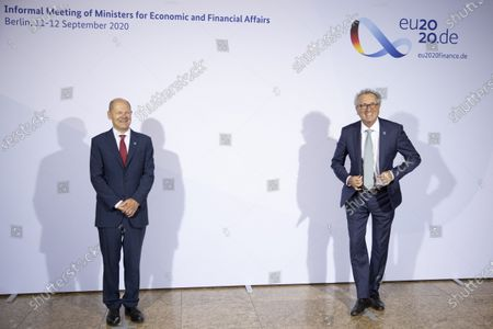 German Finance Minister and Vice Chancellor Olaf Scholz welcomes Luxembourg's Finance Minister Pierre Gramegna prior to an informal meeting of European Union ministers for economic and financial affairs on September 11, 2020 in Berlin, Germany.