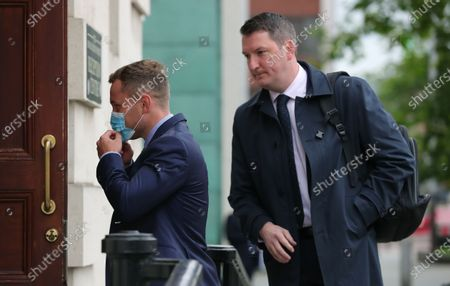 Carl Frampton pictured with John Finucane MP as he heads into a High Court showdown with Barry McGuigan in Belfast.Mr Frampton, 32, is suing Mr McGuigan, his wife Sandra McGuigan and Cyclone Promotions (UK) Ltd, claiming a failure to pay purse money from his bouts.