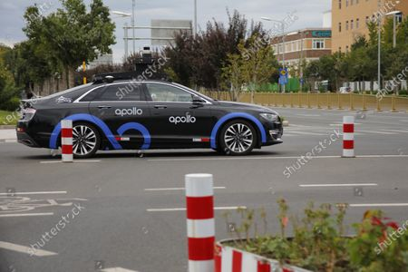 A test car of Baidu self-driving taxi drives on a road in Beijing, China, 11 September 2020. Chinese Internet giant Baidu rolls out its self-driving taxi service named 'Apollo Go' in Beijing. About 40 autonomous cabs are put into a trial operation initially in a trial area with a total 700 km, covering Beijing's major residential and business districts in the Yizhuang, Haidian and Shunyi districts.