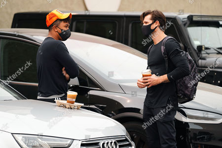 Brandon Armstrong and Gleb Savchenko are seen talking to one another.