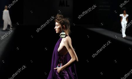A model presents a creation by Spanish designer Marcos Luengo of the Spring/Summer 2021 season during the Mercedes-Benz Fashion Week Madrid, in Madrid, Spain, 11 September 2020. The MBFWMadrid runs from 10 to 13 September.
