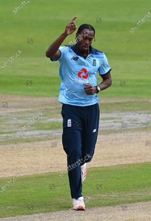 England's Jofra Archer celebrates the dismissal of Australia's David Warner during the first ODI cricket match between England and Australia, at Old Trafford in Manchester, England