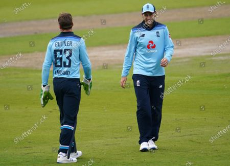 England's Joe Root, right, interacts with wicketkeeper Jos Buttler during the first ODI cricket match between England and Australia, at Old Trafford in Manchester, England