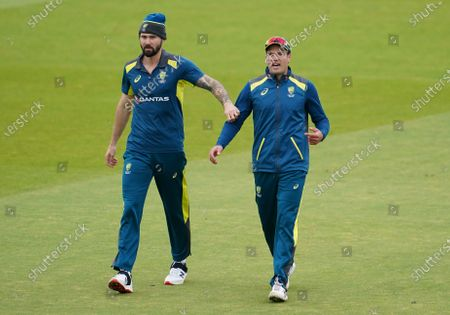 Stock Image of Australia's Alex Carey, right, and Kane Richardson warm up ahead of the first ODI cricket match between England and Australia, at Old Trafford in Manchester, England