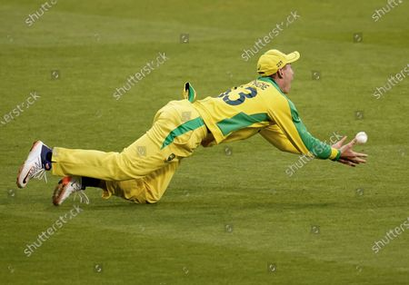 Australia's Marnus Labuschagne takes the catch to dismiss England's Jos Buttler during the first ODI cricket match between England and Australia, at Old Trafford in Manchester, England