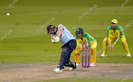 England's Jos Buttler left, hits a shot before it is caught by Australia's Marnus Labuschagne during the first ODI cricket match between England and Australia, at Old Trafford in Manchester, England