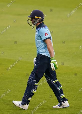 England's Jos Buttler walks off the field after being dismissed by Australia's Adam Zampa during the first ODI cricket match between England and Australia, at Old Trafford in Manchester, England