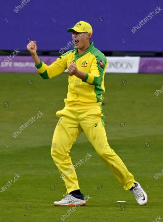 Australia's Marnus Labuschagne celebrates after taking the catch to dismiss England's Jos Buttler during the first ODI cricket match between England and Australia, at Old Trafford in Manchester, England