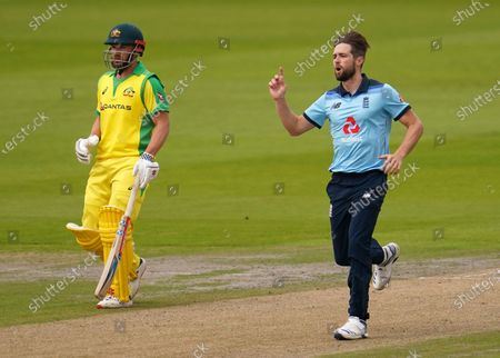 England's Chris Woakes, right, reacts after bowling a delivery to Australia's David Warner during the first ODI cricket match between England and Australia, at Old Trafford in Manchester, England