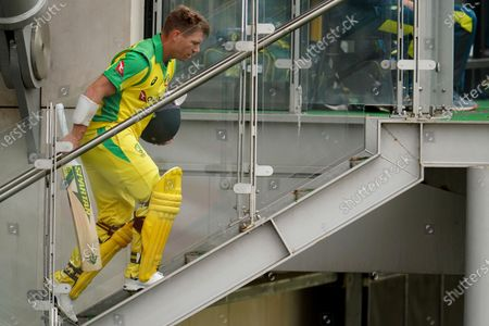 Australia's David Warner returns to dressing room after being dismissed by England's Jofra Archer during the first ODI cricket match between England and Australia, at Old Trafford in Manchester, England