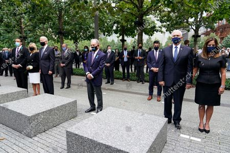 From left, New York Gov. Andrew Cuomo, Jill Biden with her husband Democratic presidential candidate and former Vice President Joe Biden, former NYC Mayor Mike Bloomberg, Vice President Mike Pence and his wife Karen, observe a moment of silence during a ceremony organized by the Tunnel to Towers Foundation on in New York. The names of nearly 3,000 victims of the Sept. 11, 2001 terror attacks will be read by family members