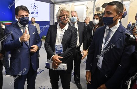 Italian Prime Minister Giuseppe Conte (L) with Co-founder of Five-Star movement (M5S) Beppe Grillo (C) and Italian Foreign Minister Luigi Di Maio (R) during the presentation of the 2019 Blue Book at the Customs and Monopolies Agency, Rome, Italy, 11 September 2020.