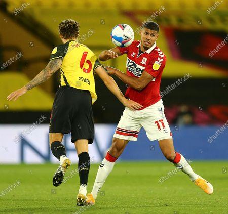 Ashley Fletcher of Middlesbrough battles with Ben Wilmot of Watford