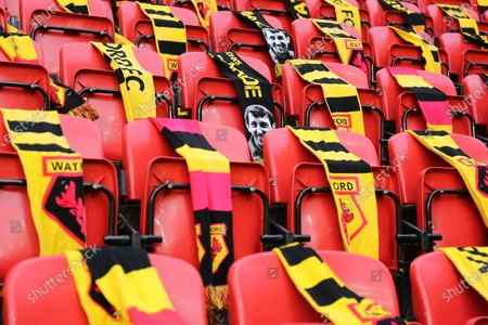Scarves with Graham Taylor graphics seen laid on Watford stadium seats