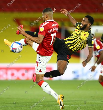 Nathaniel Chalobah of Watford challenges Ashley Fletcher of Middlesbrough