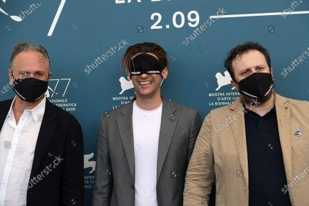 The director Pietro Castellitto (C) plays with protective mask with Massimo Popolizio (L) and Giorgio Montanini