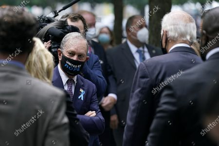 Former New York Mayor Michael Bloomberg, left, visits with Democratic presidential candidate and former Vice President Joe Biden at the National September 11 Memorial in New York, before a ceremony marking the 19th anniversary of the Sept. 11 terrorist attacks