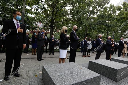 (L-R) New York State Governor Andrew Cuomo, Jill Biden along with her husband, Former US Vice President Joseph Biden, Former Mayor of New York Michael Bloomberg, Vice President Mike Pence, wife Karen and Governor of New Jersey Phil Murphy stand at attention during the playing of the National Anthem at the 19th anniversary commemoration ceremony  of the 11 September 2001 terrorist attack on the World Trade Center in New York, USA, 11 September 2020.